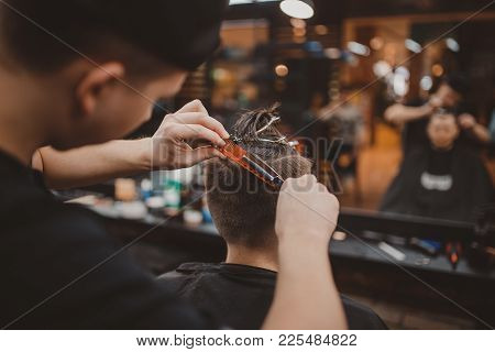 Barber Shop. Barber Master Hairdresser Does Hairstyle And Style With Scissors And Comb. Concept Barb