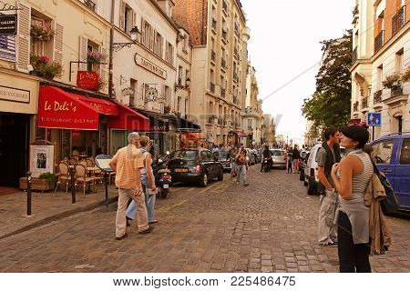 Paris, France -  August 19, 2014. Tourists Walking On Montmartre. More Than 30 Million People Visit