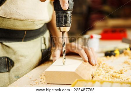 Wood Boring Drill In Mans Hand Drilling Hole In Wooden Bar, Electric Instrument Works With Wooden Su