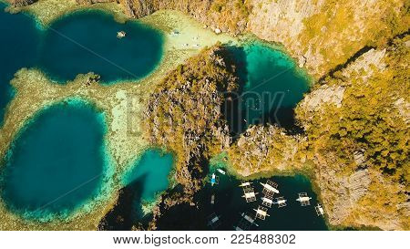 Aerial View: Twin Lagoon With Blue, Azure Water In The Middle Of Small Islands And Rocks. Beach, Tro