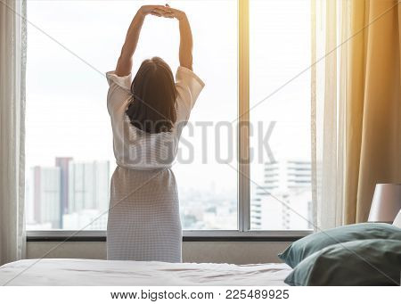 Easy Weekend Lifestyle Woman Waking Up From Sleep In The Morning Taking Some Rest, Relaxing In Comfo