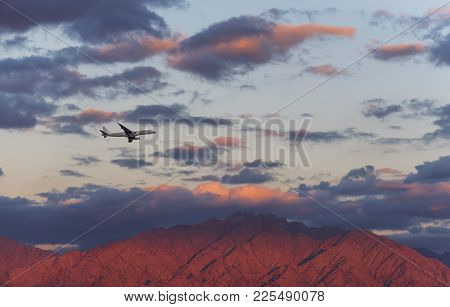 Airplane Fly Above Jordanian Mountains At Sunset, The Photo Was Taken Near Eilat And Aqaba. Here Is
