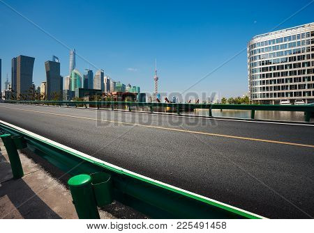 Empty Road Surface Floor With City Landmark Buildings