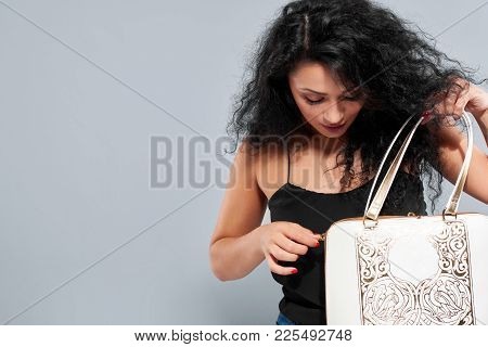 Young Pretty Girl Looks Into Her Bag, Which Looks Very Fashionable: Has Intresting Flower Pattern, G