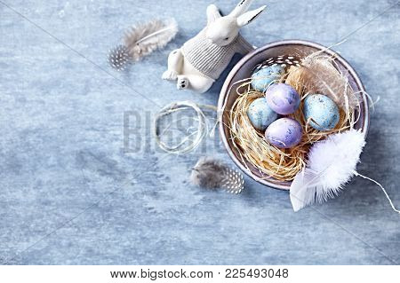 Speckled Easter Eggs in a Ceramic Bowl (flat lay arrangement)