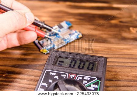 Inspecting Of The Electronic Circuit Board With The Multimeter
