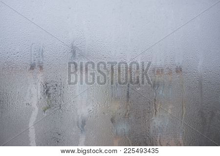 Colorful Water Drop On Glass Window Textured Background