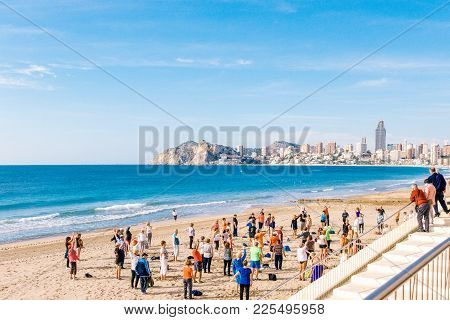 Benidorm, Spain, January 29, 2018: People Doing Exercises On The Beach. Healthy Lifestyle, Active Li