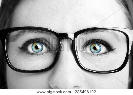 Image Of A Beautiful Young Woman Wearing Glasses. Closeup