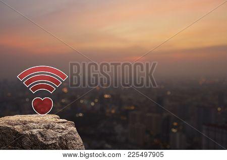 Heart Love Wifi Icon On Rock Over Blur Of Cityscape On Warm Light Sundown, Internet Online Love Conn