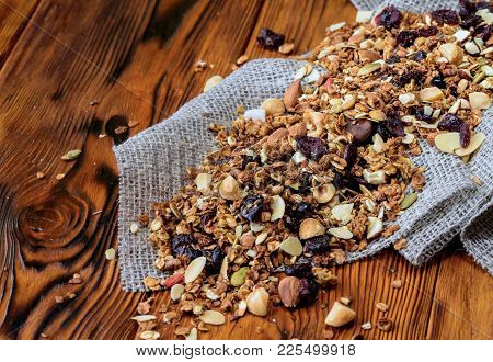 Background With Dry Granola On Old Wooden Desk