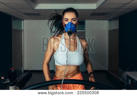 Sportswoman Monitoring Her Fitness Performance