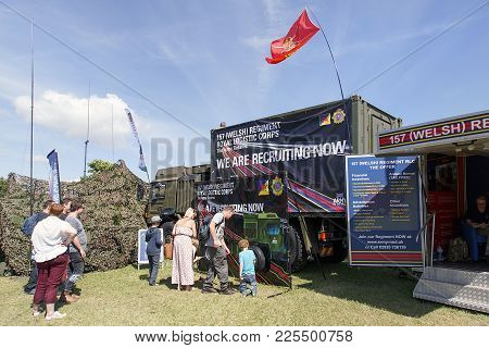 Swansea, Uk: July 07, 2017: People Look At The Advertising Posters For The Welsh Regiment Royal Logi