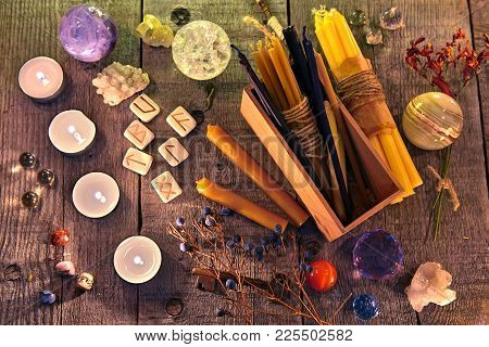 Ancient Runes, Candles, Crystals, Herbs And Magic Ritual Objects On Planks. Occult, Esoteric, Divina