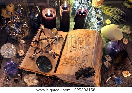 Old Witch Book With Pentagram, Black Candles, Crystals And Ritual Objects. Occult, Esoteric, Divinat