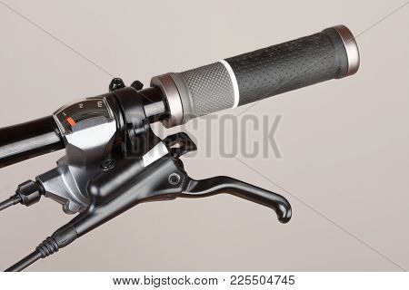 Bike 3 Speed Shifter To Left Hand On Handlebar Of Mountain Bike, Close Up View.
