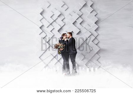 Wedding Couple, Bride And Groom Fashion Portrait, Over Gray Volumetric Background With Copyspace. Dr