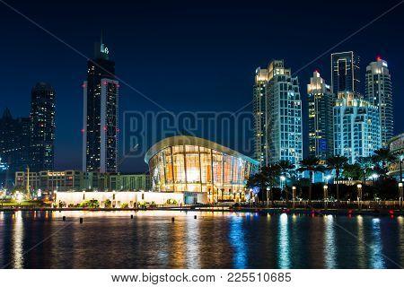 Dubai, United Arab Emirates - February 5, 2018: Dubai Opera Building Reflected In The Water At Night
