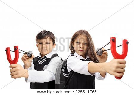 Schoolboy and a schoolgirl aiming with slingshots and rocks isolated on white background