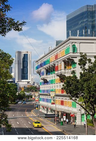 Singapore - August 18, 2009: The Colorful Mica Building In Singapore With Modern Skyscapers In The B