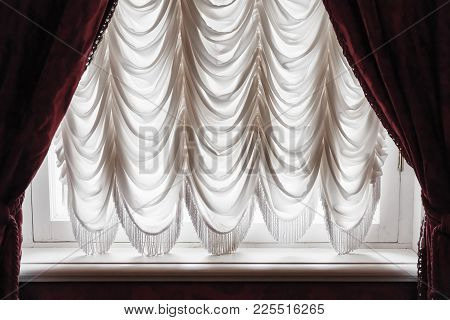 Waving Tulle And Dark Red Curtain Cover White Window. Background Photo Texture