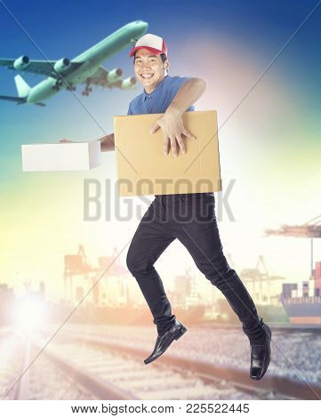 Delivery Man Holding Carton Box Toothy Smiling Face With Service Mind Against Logistic And Shipping