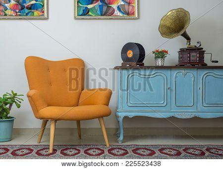 Vintage Interior Of Retro Orange Armchair, Vintage Wooden Light Blue Sideboard, Old Phonograph (gram