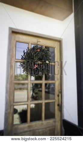 Christmas Wreath On Shop Door, Stock Photo