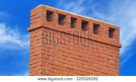 Brick Smokestack Isolated On Background Of Blue Sky