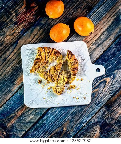 Persimmon Pie And Fresh Persimmons On A Ceramic Board, High Kitchen. Eastern Cuisine. Still-life In