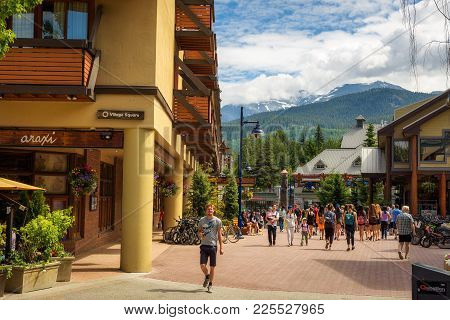 Whistler, British Columbia, Canada - July 2, 2017 : Scenic Street View With Many Tourists  In Whistl