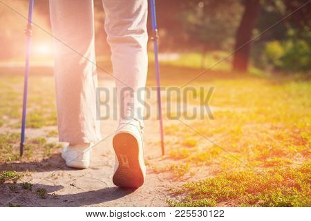 Time For Resting. Close Up Of Elderly Woman Holding Crutches In Hands While Having Adorable Walk Out