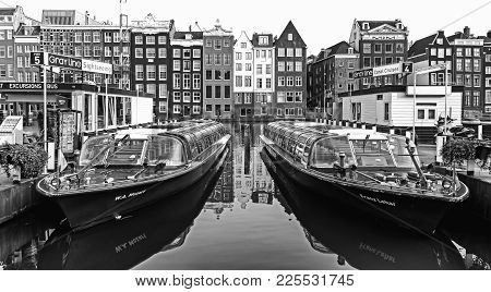 Amsterdam, Netherlands - April 3: Water Canal And Sightseeing Boats On April 3, 2014 In Amsterdam