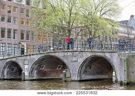 Amsterdam, Netherlands - April 3: Water Canal, Bridge And Typical Architecture In City  On April 3,