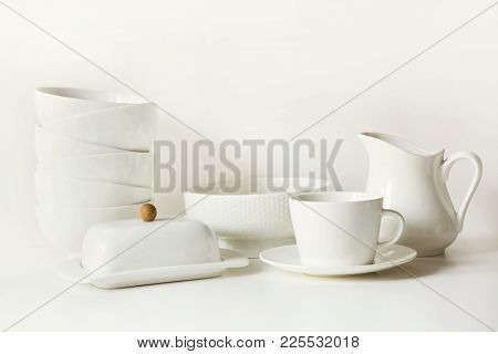 Crockery, Dish, Tableware, Utensils And Other Different White Stuff On White Table-top. Kitchen Stil