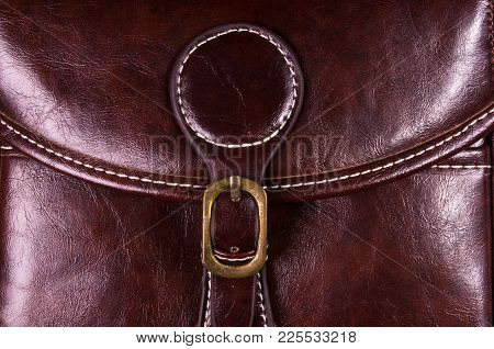 Closeup Of Buckles, Clasps, Zippers, Pockets, Fasteners, Fittings And Seams On The Brown Retro Hand