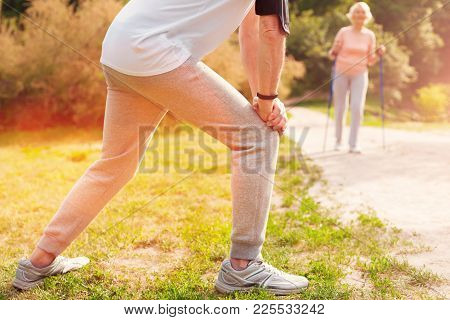 Full Of Energy. Close Up Of Enthusiastic Man Doing Exercises While Spending Time In Fresh Air