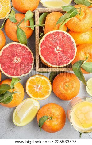 Citrus Background. Colorful Fresh Citrus Fruit On Table. Tangerine, Lime, Lemon, Grapefruit. Flat La