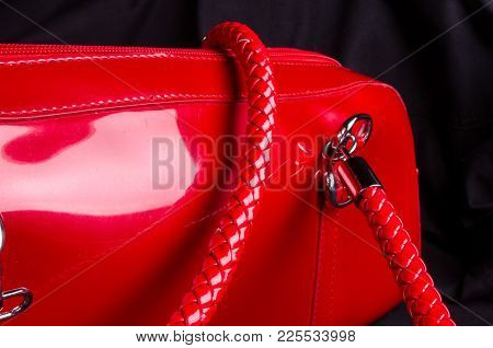 Closeup Of Buckles, Clasps, Zippers, Pockets, Fasteners, Fittings And Seams On The Red Lacquer Hand