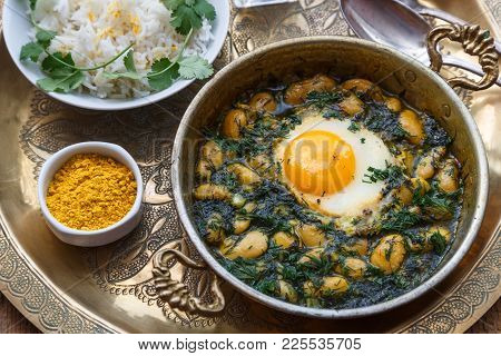 Persian Breakfast With Eggs, Bean And Dill In Copper Pan Top View