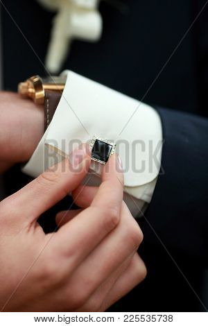 Preparing For Wedding. Groom Buttoning Cufflinks On White Shirt Before Wedding. Groom's Clothes. Clo