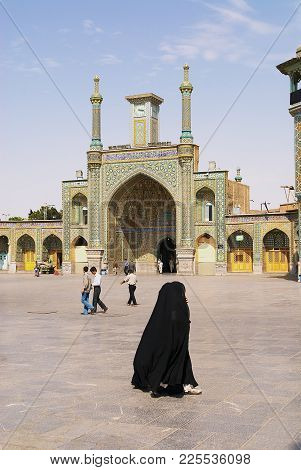 Qom, Iran - June 26, 2007: Unidentified People Walk In Front Of The Fatima Masumeh Shrine In Qom, Ir