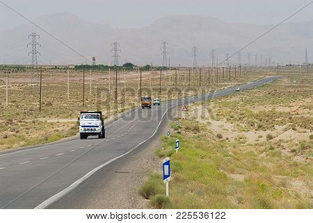 Yazd, Iran - June 19, 2007: Trucks Pass By The Countryside Road Circa Yazd, Iran.