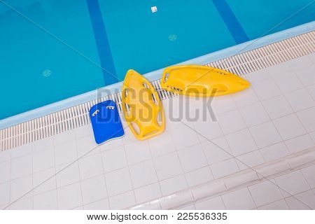 Swimming Learning Concept Photo. Large Swimming Pool With Swim Support Objects.