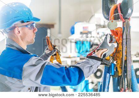 Heavy Duty Lift Crane Operator. Caucasian Ceiling Lift Worker Closeup Photo.