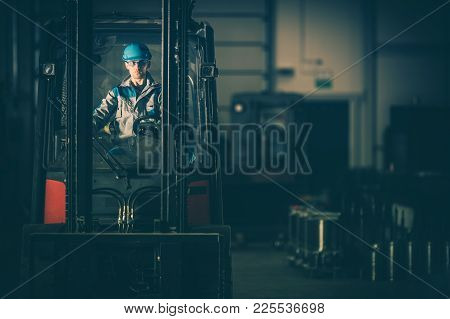 Warehouse Forklift Operator. Caucasian Worker Moving Elements On The Metalworking Production Line. C