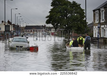 Flood Water In The Streets Of Bentley Village Yorkshire England