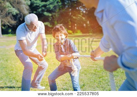 Cmon You Can Do It. Thoughtful Senior Man Getting Excited While Encouraging His Little Grandson Play