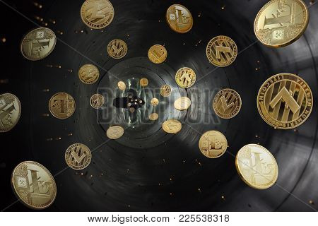 On A Gray Background Are Gold And Silver Coins Of A Virtual Digital Crypto  Currency - Litecoins In
