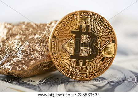 Shiny Golden Bitcoin And Gold Lump Put On Dollar Banknote And Represent New Financial Trends. Blockc